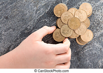 Man stacking American dollar coins - Hand of a man stacking...