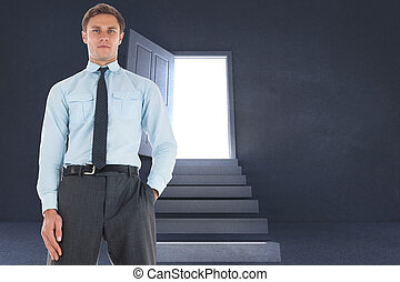 Serious businessman standing with hand in pocket against...