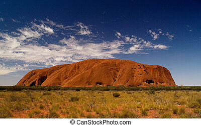 Australias Uluru Full - Uluru in red, blue cloudy sky, bush...