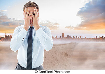 Composite image of businessman with a headache - Businessman...