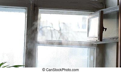 cold steam in open ventilator window frozen motion on a...