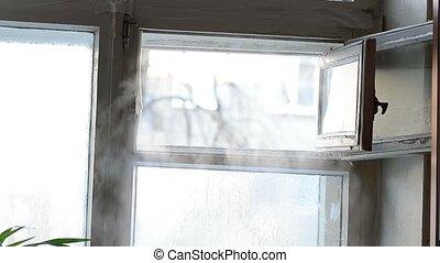 cold steam in open ventilator window. frozen motion on a...