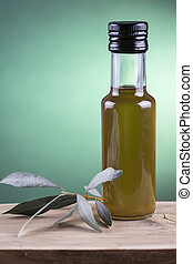 Olive oil bottle with green spotlight background