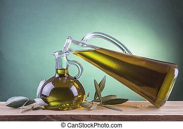 Olive oil bottles on a green spotlight background