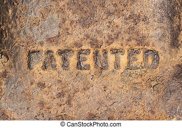 Old cast iron label patented - Old weathered rusty cast iron...