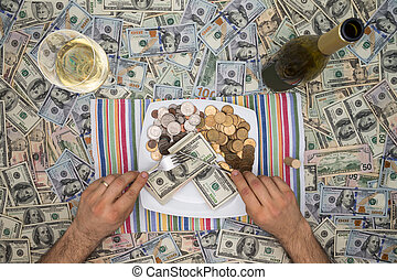 Man eating money through extravagance - Conceptual image of...