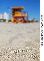 Beach with letters on the sand