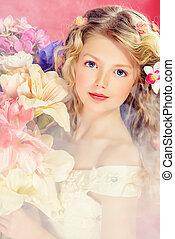 on pink - Beautiful tender girl in white festive dress holds...