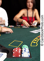 Card gambling - People playing cards, chips and players...