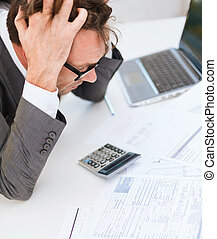 businessman with papres, laptop and calculator - tax,...