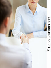businesswoman and businessman shaking hands - business and...