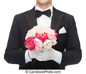 close up magician holding flower bouquet - magic,...