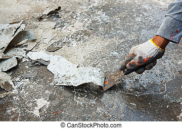 Scraping paint - Close up worker hand scraping old paint on...