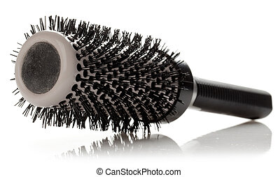Professional round hairbrush on a white background