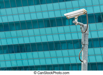 Security camera - White CCTV or surveillance camera watching...