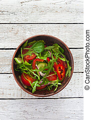 Vegetable salad with fresh tomatoes, cucumber and arugula...