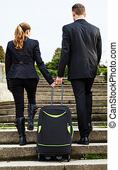 Business couple on an foreign corporate mission