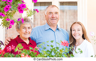 Happy elderly couple - The happy elderly couple with their...
