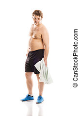Fat fitness man is posing in studio on white background.