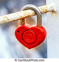 Red metal lock Key from heart of love, vintage background