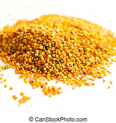 bee pollen - raw organic bee pollen over wooden board
