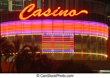 Casino neon sign at night - Casino\'s neon sign lights