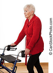 Woman with a walker - Old lady using a walker in her house