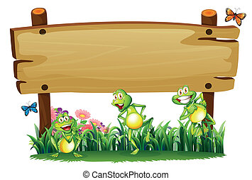 An empty wooden board at the garden with playful frogs -...