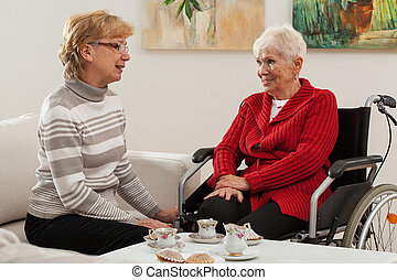 Conversation of elderly women - Elderly lady talking with...
