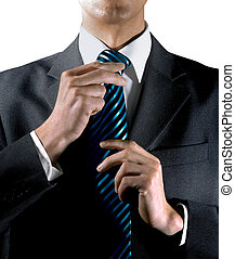 to tie ones tie - hands of businessman that is a man of...