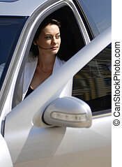 Businesswoman in the premium car - Businesswoman rolled down...