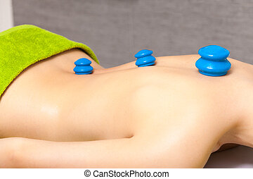 Beauty salon Woman getting spa cupping glass vacuum massage...