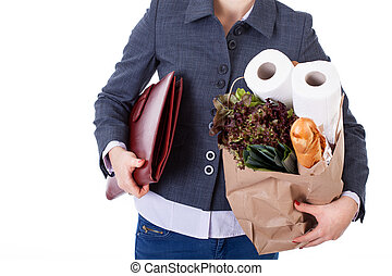 Businesswoman grocery shopping - An elegant businesswoman...