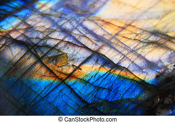 Labradorite mineral background blue and yellow typical...