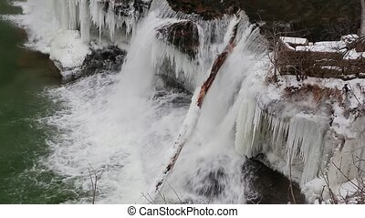 Icy Waterfall Loop - Whitewater plunges over a frozen...
