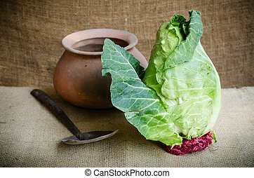 Collard - Fresh and ripe green collard with clay pot on...