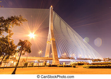 The Rama VIII bridge at night in Bangkok, Thailand