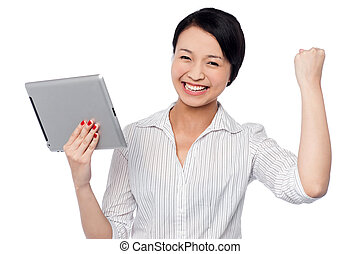 Excited businesswoman holding touch pad - Excited young...
