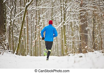 Winter jogging - Young runner in winter jogging in park.