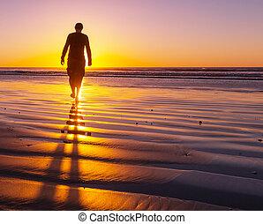 Boy on the beach - man on the beach