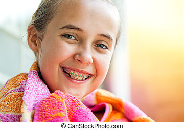 Cute girl with dental braces. - Close up outdoor portrait of...