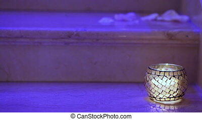 Candle in ware - Lonely burning candle on the marble steps...
