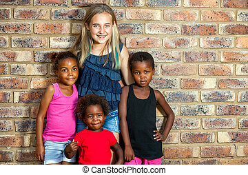 Caucasian girl with african friends.