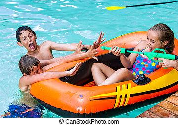 Kids having fun with water gun - Children in outdoor...