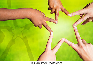 Kids joining fingers forming a star - Multiracial childrens...