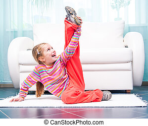 little girl playing sports at home