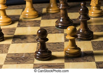 Chess - a close up of a chess game.