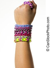 Rubber band bracelets - A childs arm with colorful rubber...