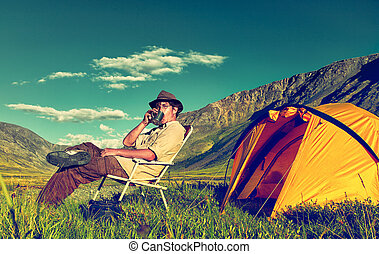 Tourist in camp - Colorized vintage outdoor portrait of...