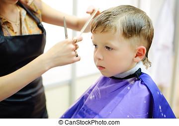 boy getting haircut - five year old boy having his hair cut